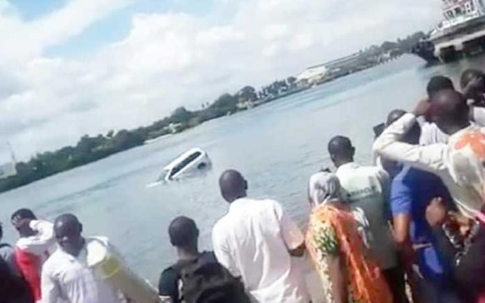 Onlookers at the Island side ramp of the Likoni channel in Mombasa, Kenya, where a vehicle plunged into the Indian Ocean. September 29, 2019.