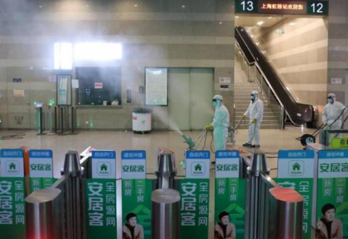 Workers in protective suits disinfect the Shanghai Hongqiao Railway Station following the Coronavirus outbreak on January 27, 2020