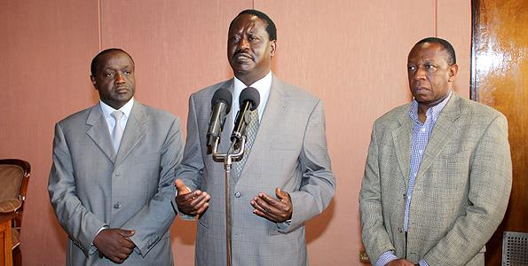 AU envoy Raila Odinga (c) with then Kenya High Commissioner in Nigeria Francis Sigei (l) and then Senior Deputy Secretary in the Prime Minister's office Abdul Mwasera (r) at Jomo Kenyatta International Airport in January 2011.