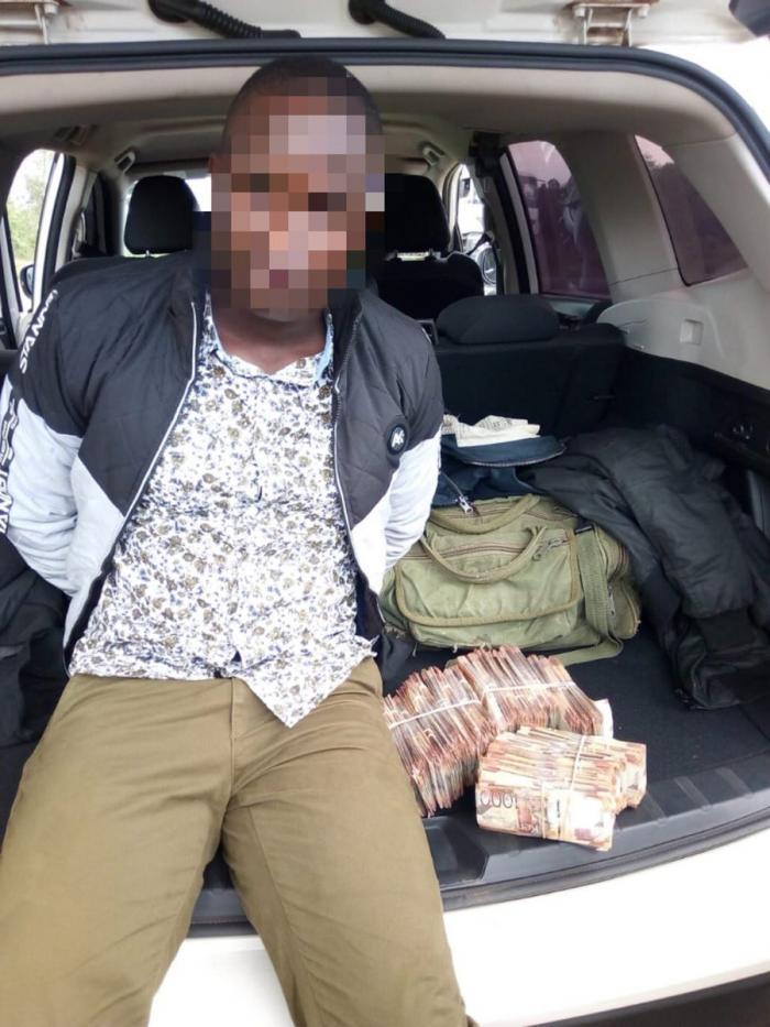 A photo posted by the DCI of one of the arrested officers. DCI stated that they were planning to travel to Uganda with the cash