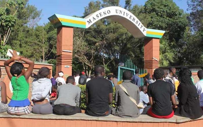 Maseno University students at the institution's main entrance