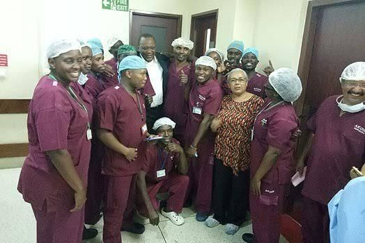 President Uhuru Kenyatta and First Lady Margaret Kenyatta with doctors and midwives at Aga Khan Hospital.