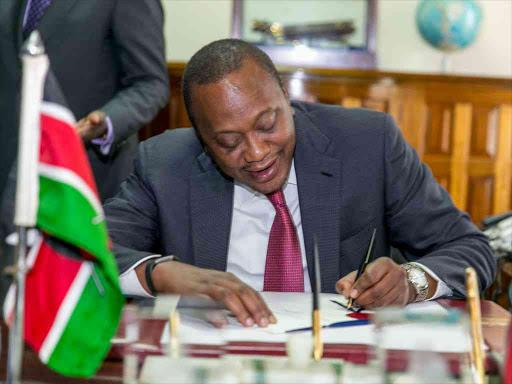 President Uhuru Kenyatta signing into law the Finance Bill 2019.
