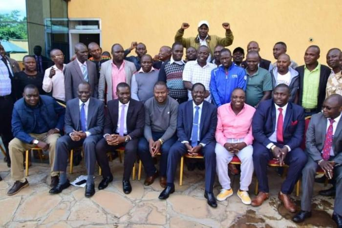 ODM leader Raila Odinga posing for a photo with ODM-allied MCAs and other ODM delegates after a consultative meeting in Nairobi on Tuesday, November 19.