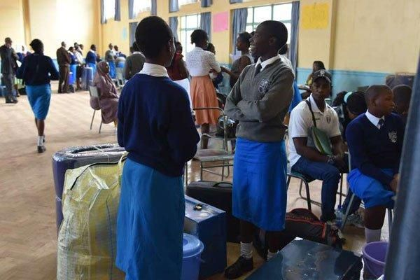 Form One students report to Pangani Girls in Nairobi on January 9, 2018.