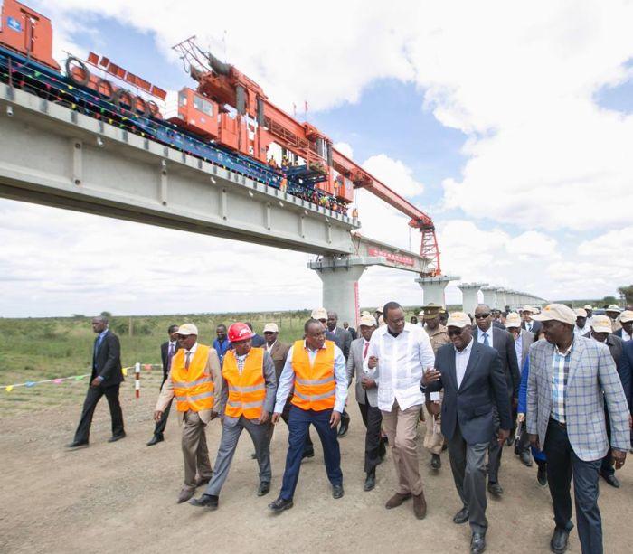 President Uhuru Kenyatta at SGR construction site at Kyang'ombe (DK2 Project Site) in Nairobi where he witnessed the installation of bridge girders for the Nairobi-Naivasha SGR line.