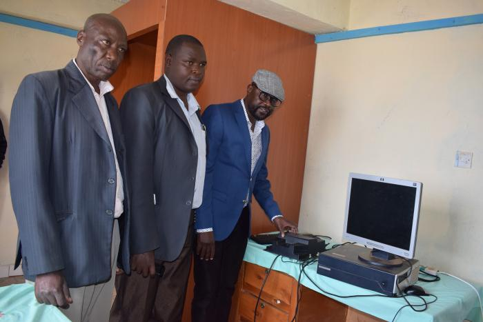 Prof. Oborah shows the Athropo-Biometric Kits and accessories that will be installed at the Nyamira Talent Clinic