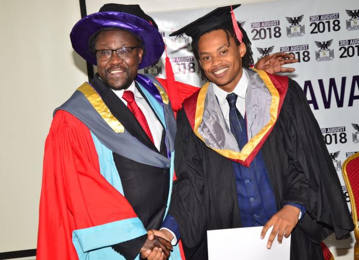 Prof Humprhey Oborah with George Njenga during a graduation ceremony