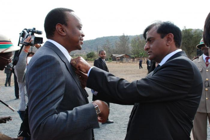Billionaire Narendra Raval (right) with President Uhuru Kenyatta while launching a road's construction at the coast region.