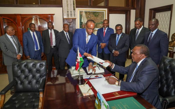 President Uhuru Kenyatta when he signed the National revenue redistribution bill. He on Thursday, November 7 signed into law a Finacial Act raising taxes.