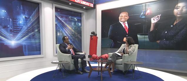 Ngunjiri Wambugu with K24's Anne Kiguta. He asserted that he was a peace crusader
