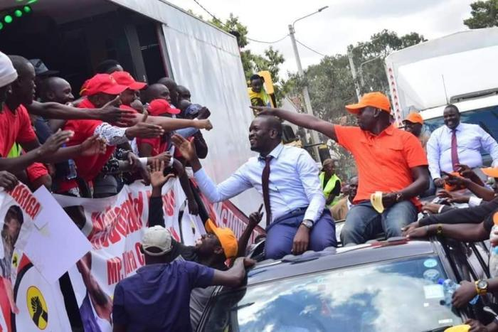 Jubilee's McDonald Mariga and ODM's Imran Okoth greet each other on Tuesday, September 10, after both were awarded nomination certificates by their parties. IEBC barred Mariga from contesting in the race