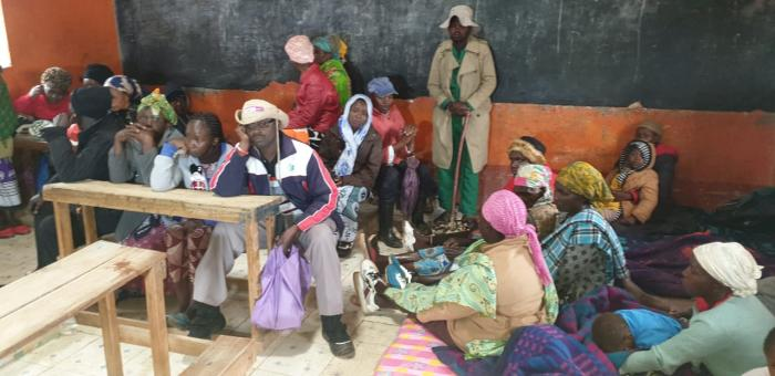 Victims of the destruction caused by the floods in Makueni assembled in a classroom, December 2.