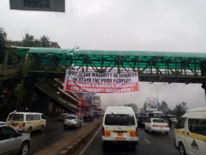 A banner plastered on a footbridge along Thika Super Highway.