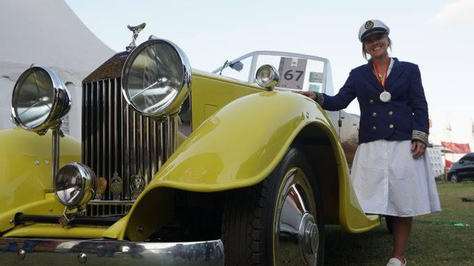 Veronica Wroe poses next to her 1930 Ford Model A at the 2019 Concours d'Elegance in Nairobi