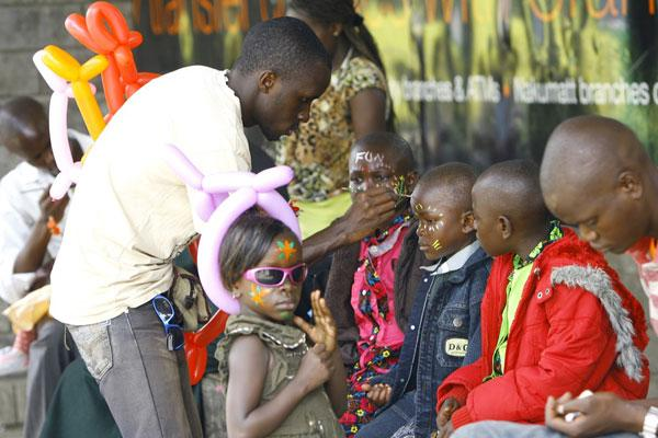Children line up to have their faces painted at the Uhuru recreational gardens in Nairobi.