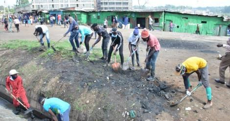 Youth partake in a clean-up exercise as part of the Kazi Mtaani program.