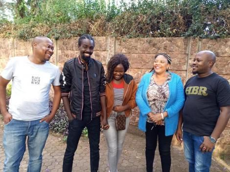 Former TPF contestant David Major (second left) holds his sister's hand after they were reunited after 5 years