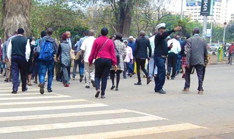 Stock image of Kenyans crossing a street in Nairobi.