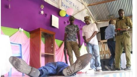 Pastor Elijah Misiko of 3 G Ministries laying on the floor after he stabbed himself