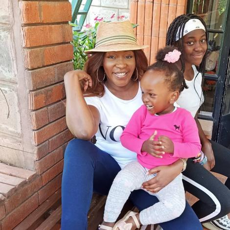 Terryanne Chebet poses with her two daughters.