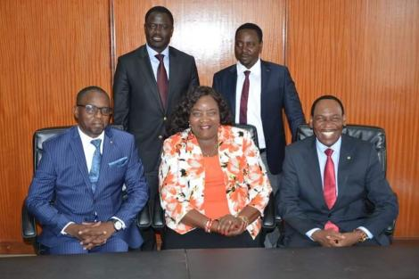 Mama Ida Odinga (centre), KFCB CEO Ezekiel Mutua (right), and other leaders pose for a photo at the EA Spectre on Tuesday, February 18, 2020