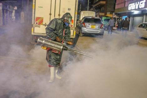 A member of Sonko Rescue Team using a steam fumigation machine