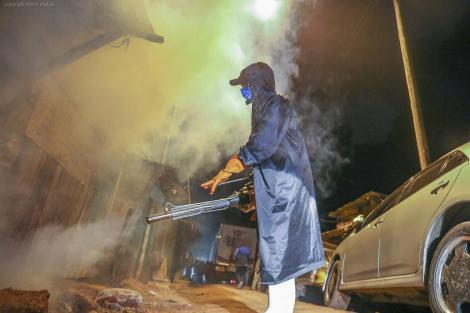 A member of the Sonko Rescue Team fumigates a city neighbourhood on April 3, 2020.