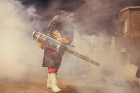 An individual clad in protective attire fumigating Nairobi streets on April 3, 2020..
