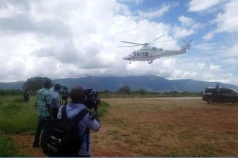 A journalist records as a chopper airlifts Governor Mike Sonko from Voi to Nairobi in December 2019.