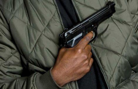 A man carrying a gun.