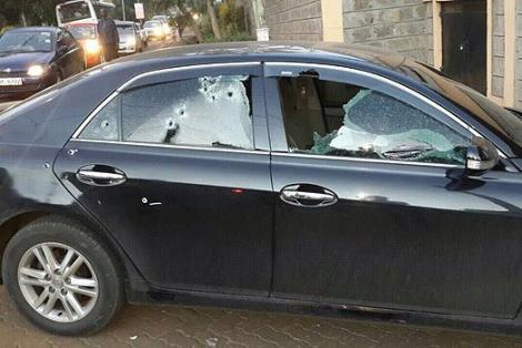 A salon car riddled with bullet holes.