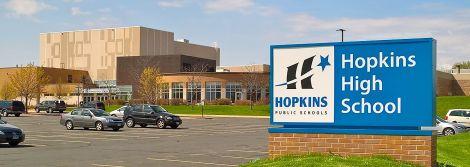 A signpost showing Hopkins High School