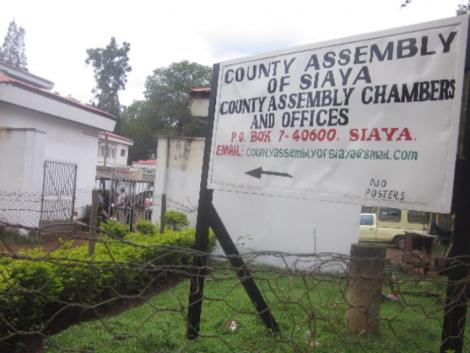 A signpost showing Siaya County Assembly