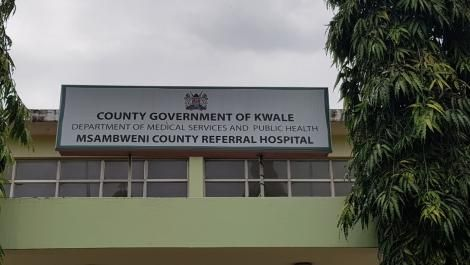 A signpost showing the Msambweni County Referral Hospital