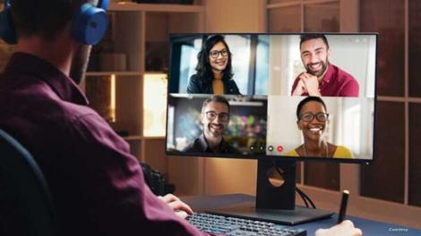 A user watches a video conference in a promotional image from Gumzo.