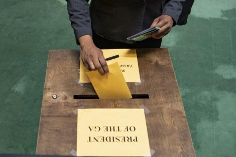 A voter casting a ballot at the United Nations General Assembly on June 17, 2020.