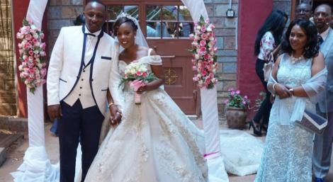 Abraham Kimani and his bride Erica Mukisa pose for a photo on their wedding day, February 20. 2019.