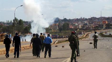 Anti-riot officers pictured along Thika Superhighway, Githurai area during a mass protest on September 9, 2014.