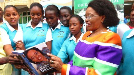 Outgoing Karen Hospital CEO Betty Gikonyo with school girls
