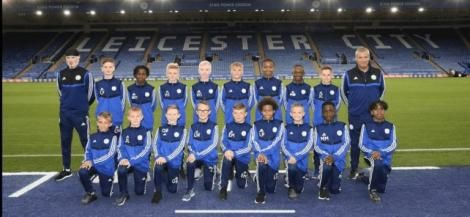 Brooklyn Mwadime Kazungu (Back row third from left) poses for a team photo at the King Power Stadium.