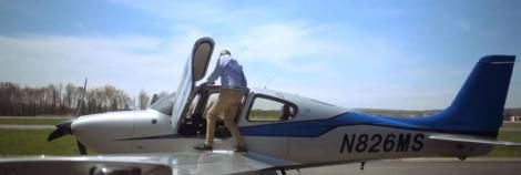 Captain Tom Rege boarding one of his flight school planes.