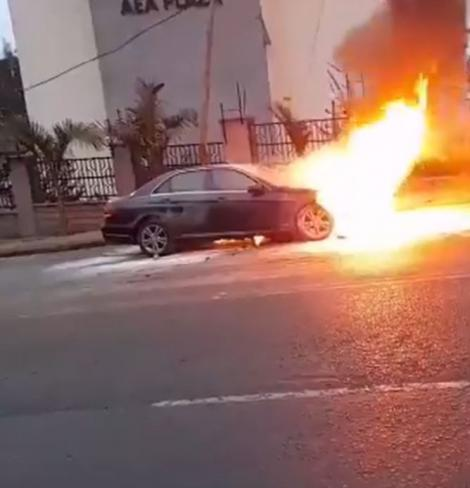 Photos of a Mercedes Benz up in flames along Valley Road in Nairobi
