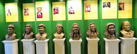 Carvings of previous Chief Justices who have served in Kenya, on display at the Judiciary Museum of Kenya.