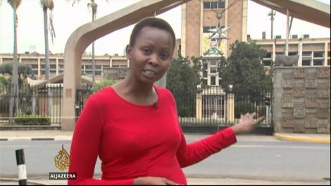 Catherine Wambua Soi reporting outside Kenya's Parliament building.