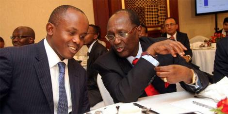 Centum CEO James Mworia (left) and businessman Chris Kirubi confer during the company's investor briefing at the Nairobi Serena Hotel on November 13, 2013.