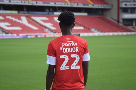 Barnsley left-back Clarke Oduor poses at the Oakwell Stadium in England after being unveiled on August 25, 2019
