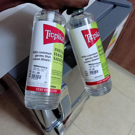 Photo of Two similar 500ml bottles of hand-sanitizer bought at Cleanshelf Supermarket in Ruaka with stickers indicating different prices (Ksh1000 and Ksh950)