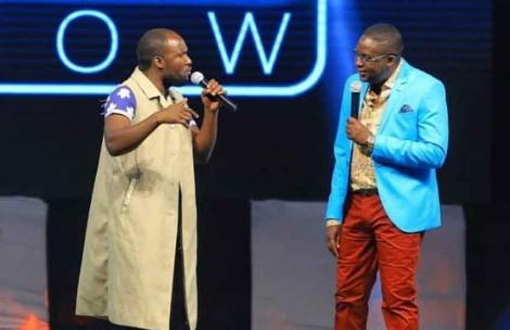 Comedy actor Steven Oduor Dede alias DJ Shiti (Left) and Daniel Churchill Ndambuki performing on stage.