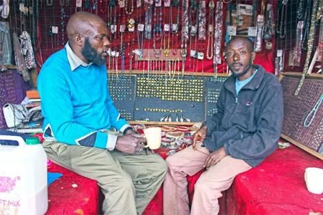 Timothy Mbugua (left) a shop owner who runs a non-profit programme — Rewind 254, aimed at rehabilitating the youth in Kiambu County with Potash Charles Matathia (right) during an interview in August 2018